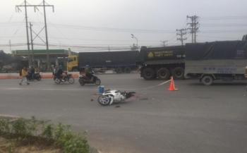 binh duong xe container can chet nguoi roi bo chay nguoi dan buc xuc truy duoi gan 1km