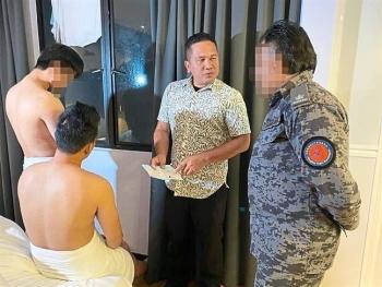malaysia bat 2 nguoi dan ong viet hanh nghe mat xa bat hop phap