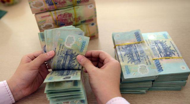Doanh nghiệp có nợ xấu sẽ được vay để trả lương ngừng việc, phục hồi sản xuất